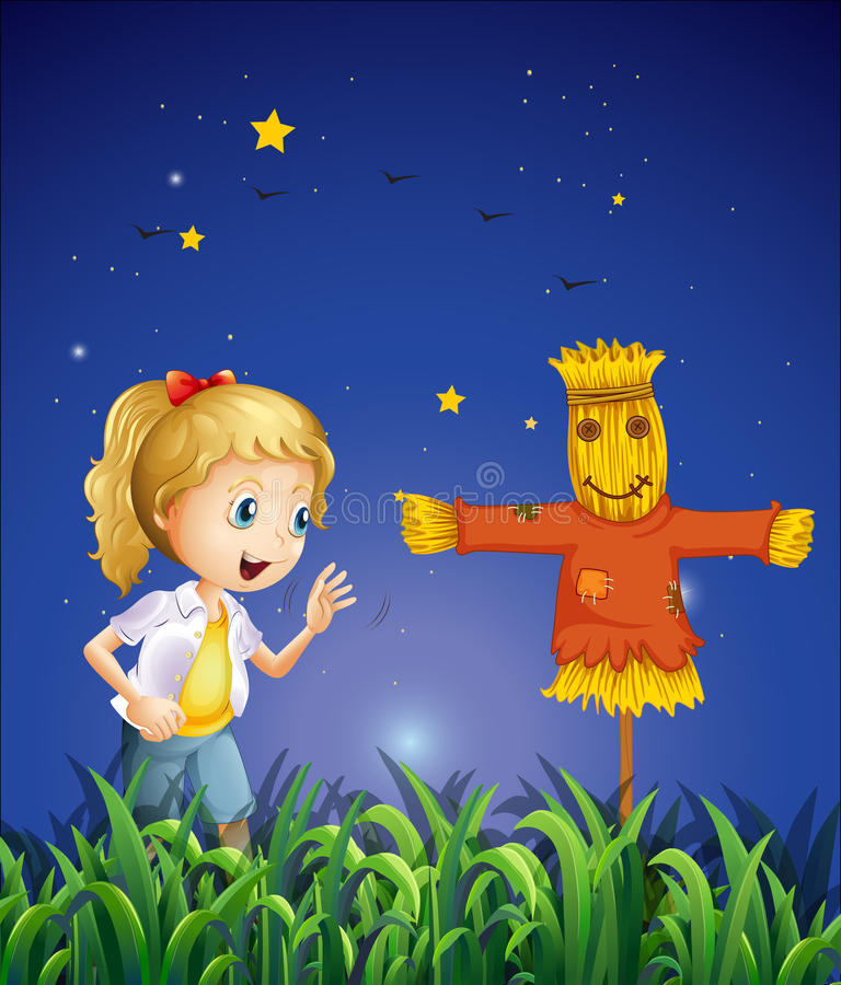 A young girl beside the scarecrow