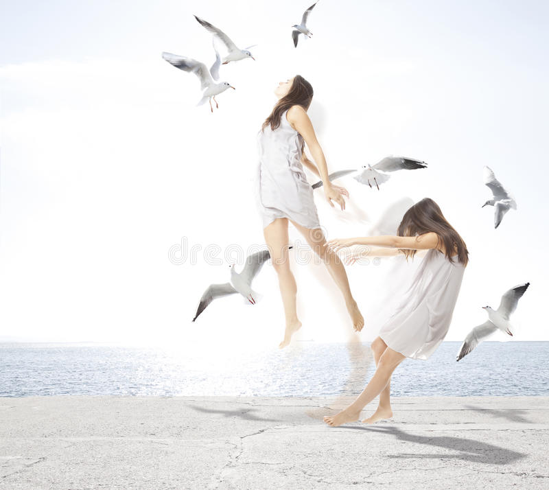 Young girl with seagulls, separation of the soul royalty free stock images