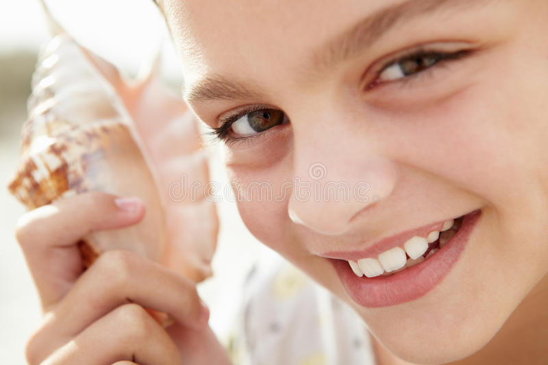 Young girl with seashell royalty free stock photography