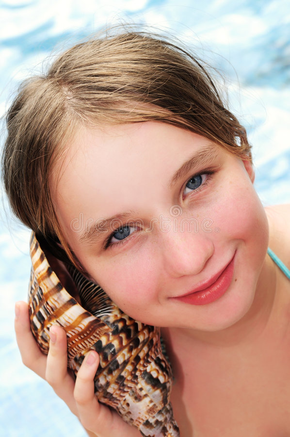 Download Young girl with seashell stock photo. Image of coast, escape - 4697856