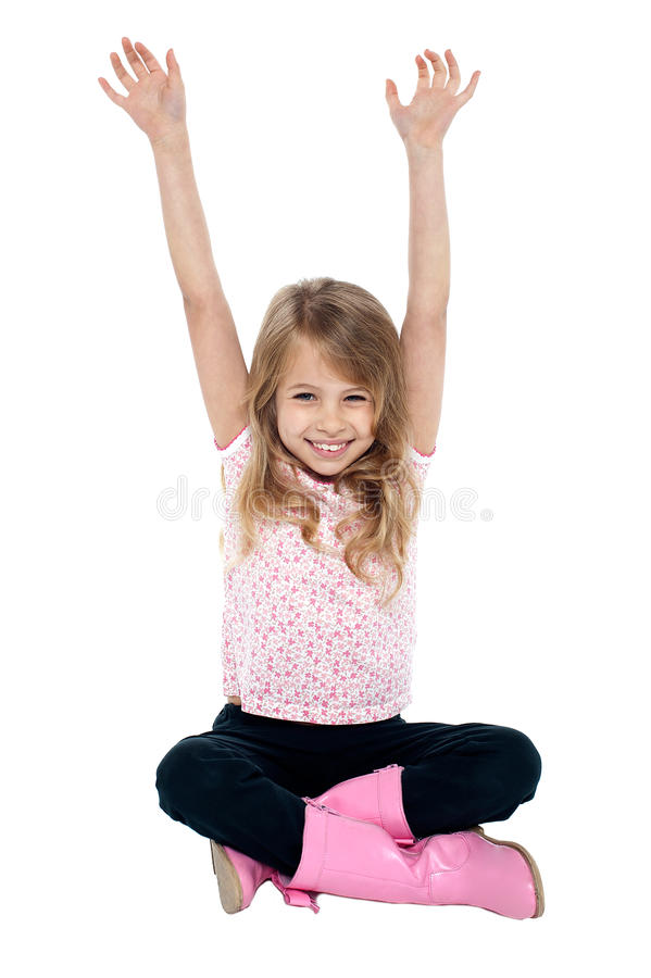 Download Young Girl Seated On Floor Posing With Raised Arms Stock Image - Image: 29071669
