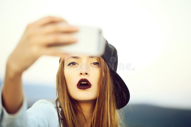Young girl making selfie stock image