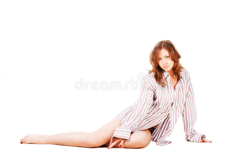 Young girl in a shirt on a floor stock image