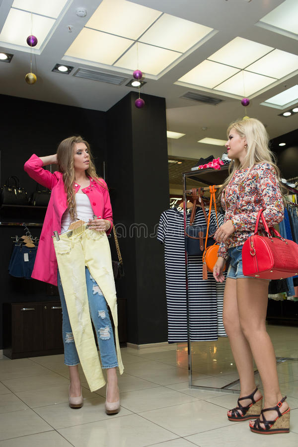 Young girl in a shop buying clothes stock photo