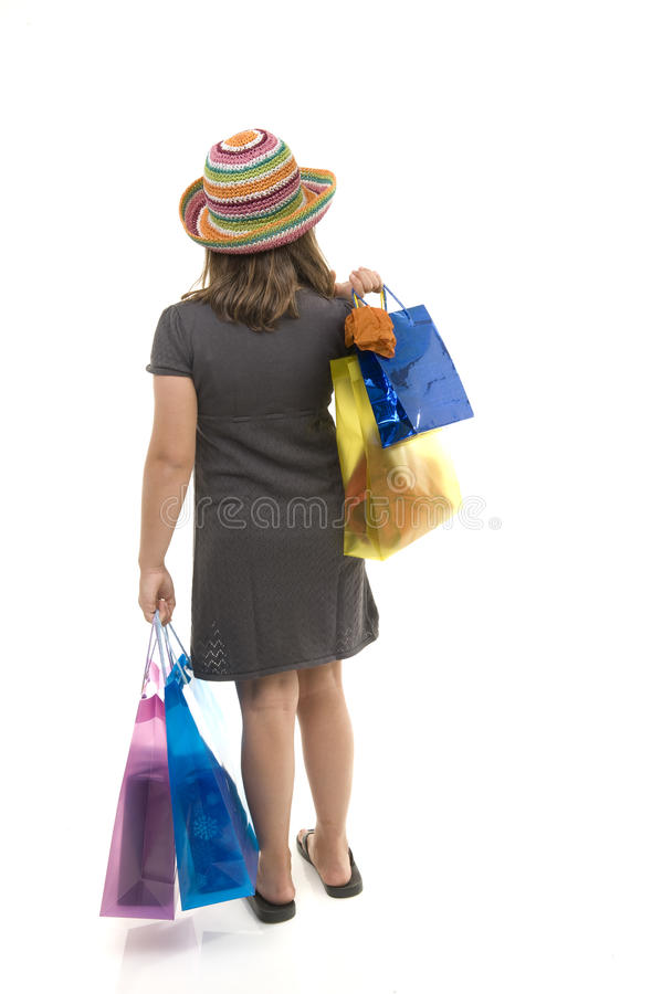 Young girl with shopping bags from behind royalty free stock image