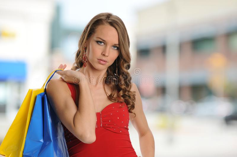 Young girl with shopping bags royalty free stock photo