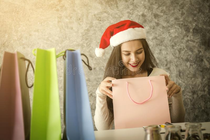 Young girl shopping on christmas day or xmas sale time. stock image