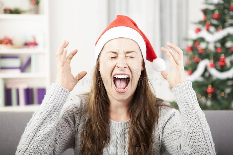 Young girl shout because of christmas stress royalty free stock image