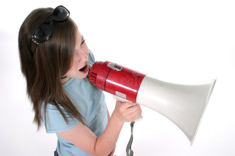 Young Girl Shouting Through Megaphone 4. Young girl shouting, speaking, or singing through a megaphone. Shot on white royalty free stock images