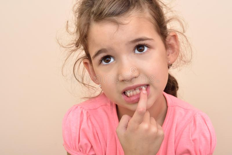 Young girl showing a missing tooth royalty free stock photo