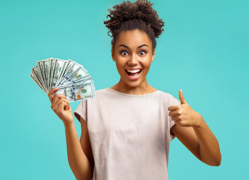 Young girl shows money and like gesture. stock image