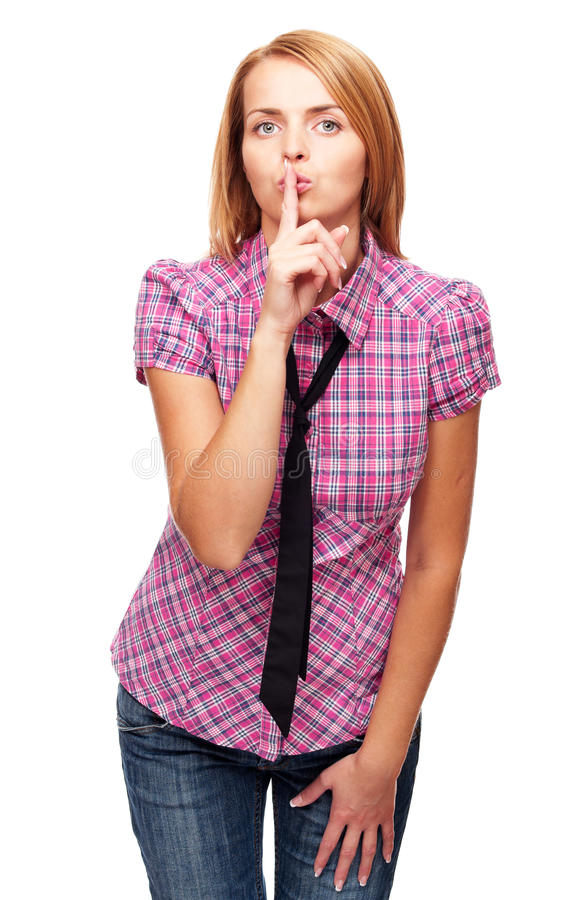Young girl shows silence or secret gesture stock photos