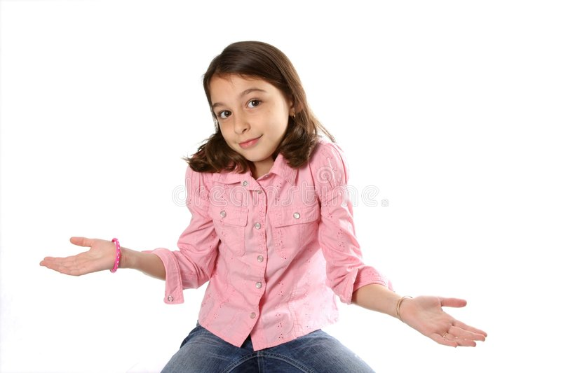 Young Girl shrugging shoulders. Young girl / child shrugging shoulders against white background stock photos