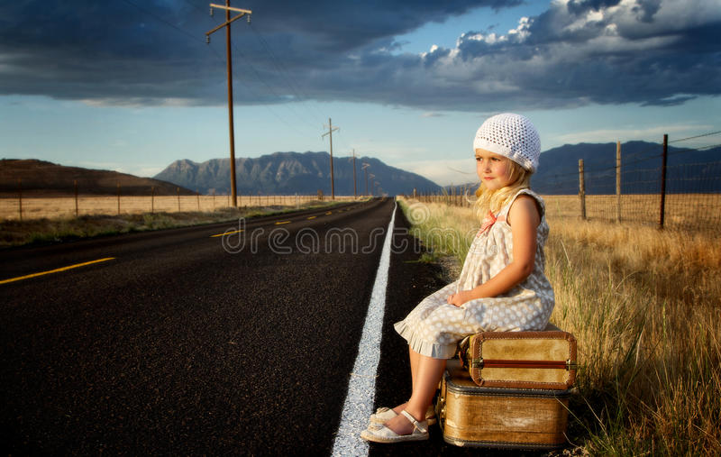 Download Young Girl On Side Of Road With Suitcases Stock Image - Image of luggage, field: 25952465