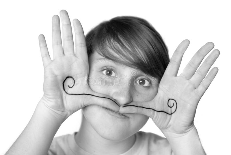 Young Girl Silly Face Mustache royalty free stock photos