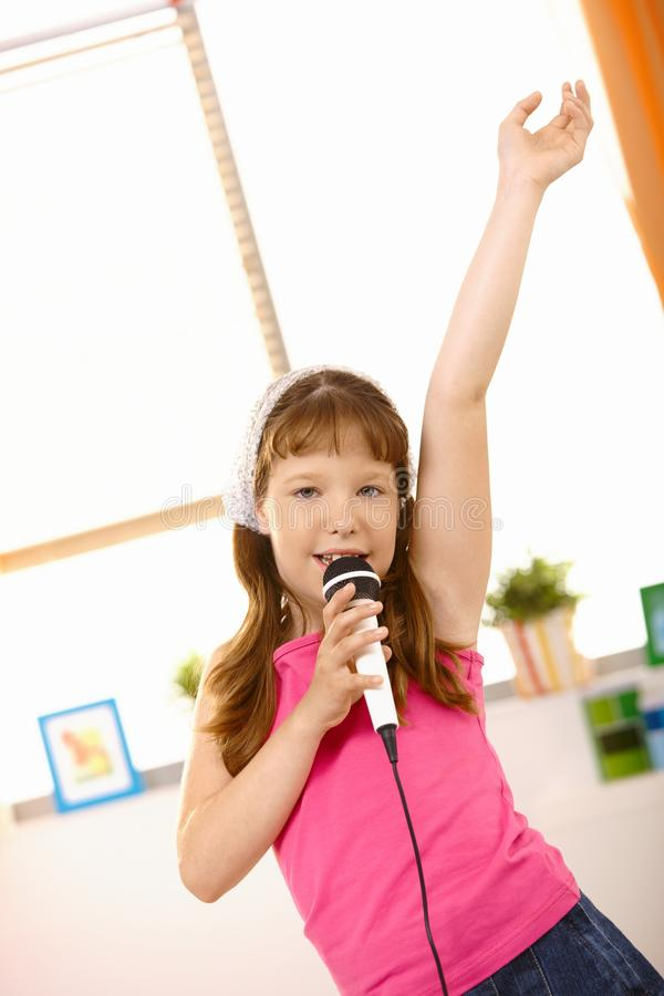 Free Young Girl Singing With Hand Up High Royalty Free Stock Photo - 18493265