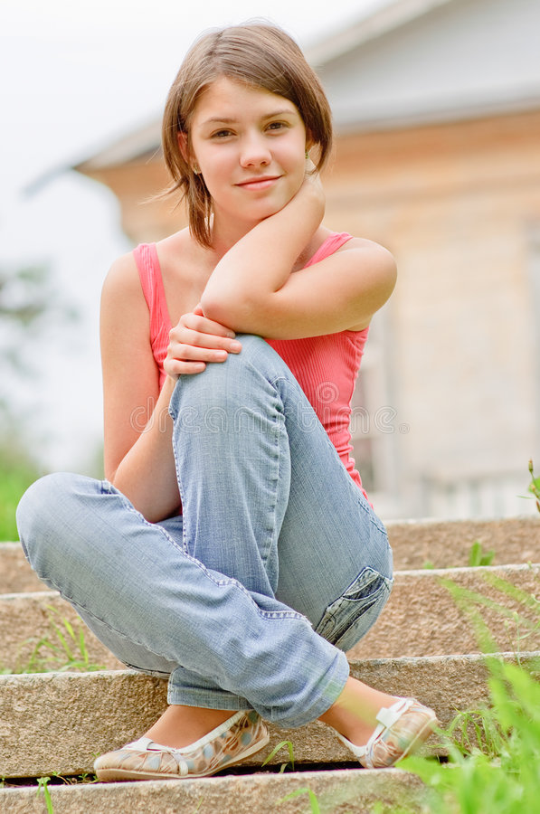 Young Girl Sits On Steps Royalty Free Stock Photo