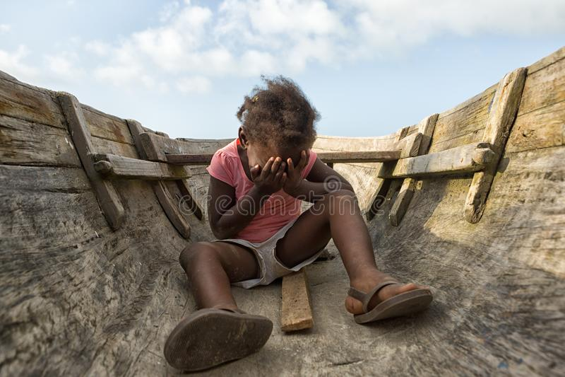 Young girl sitting in canoe in Honduras stock image
