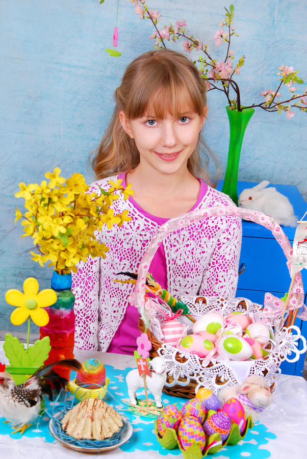 Download Young Girl  Sitting At The Easter Table Stock Image - Image: 29460583