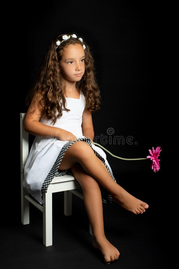 Young girl with flower in her hand royalty free stock photography