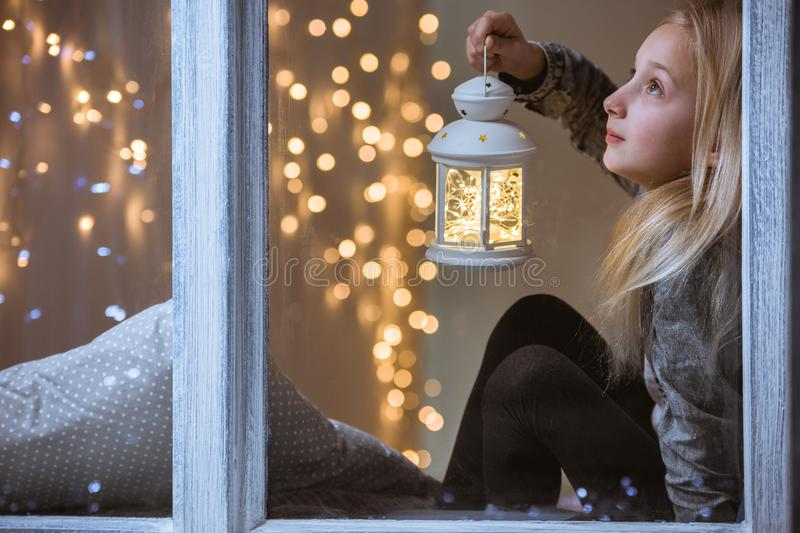 Girl holding a lantern royalty free stock image