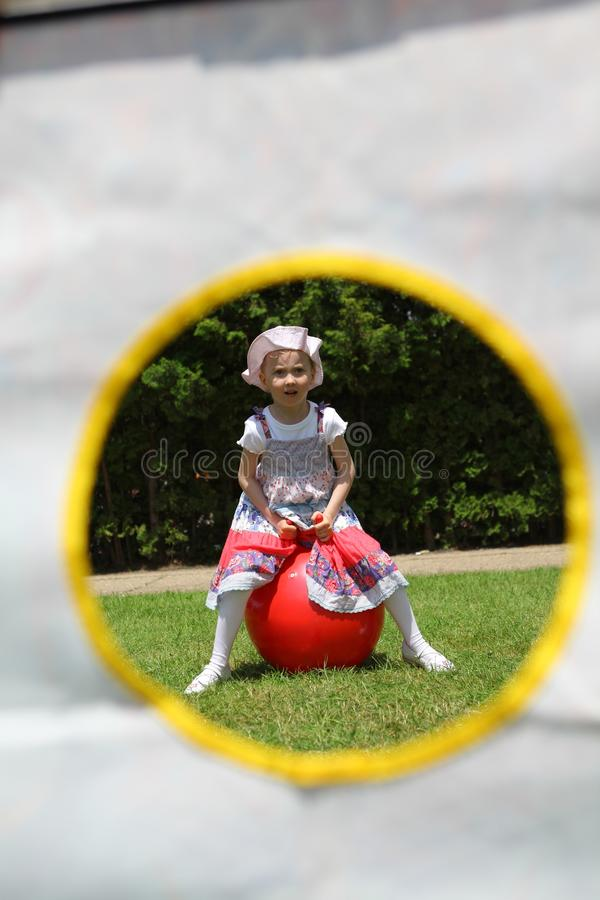 Young girl sitting on red fitness - framed stock images