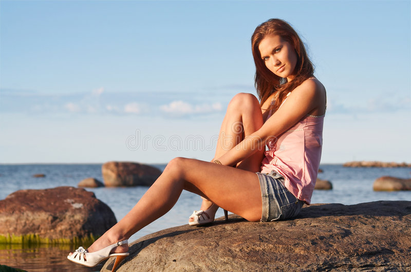 Download Young Girl Sitting On A Stone Stock Image - Image: 6085561