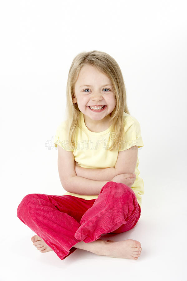 Young Girl Sitting In Studio royalty free stock images