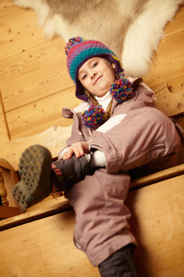 Young Girl Sitting On Wooden Seat stock images
