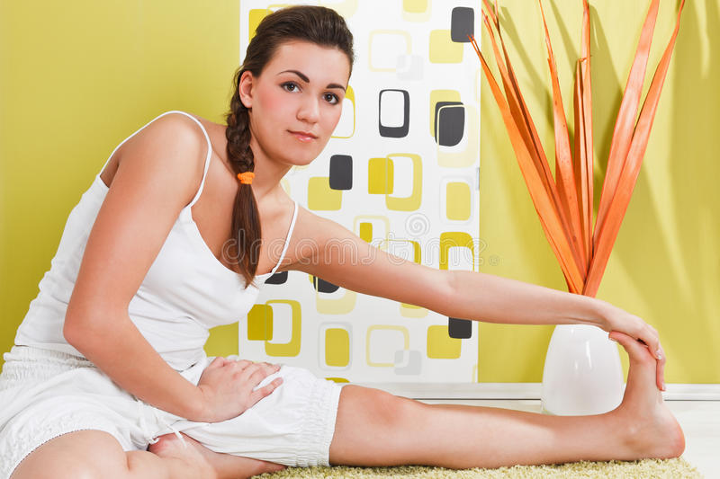 Download Young Girl Sitting In A Yoga Position Stock Photo - Image: 17971768
