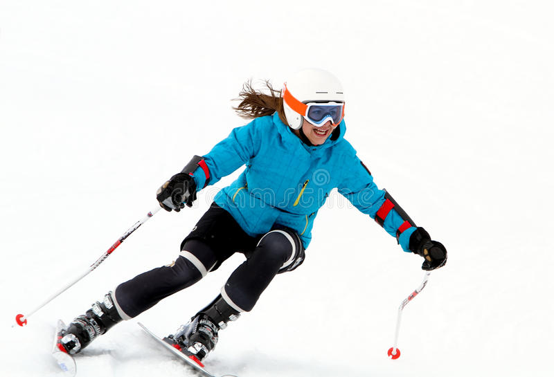 Young girl skiing. stock photos