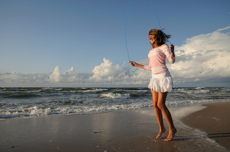 Download Young Girl Skipping On The Beach Royalty Free Stock Photo - Image: 6258615