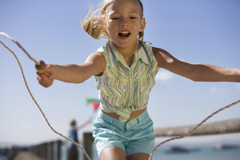 A young girl with a skipping rope stock photography