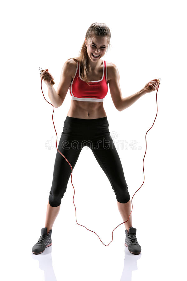 Young girl with a skipping rope royalty free stock photos