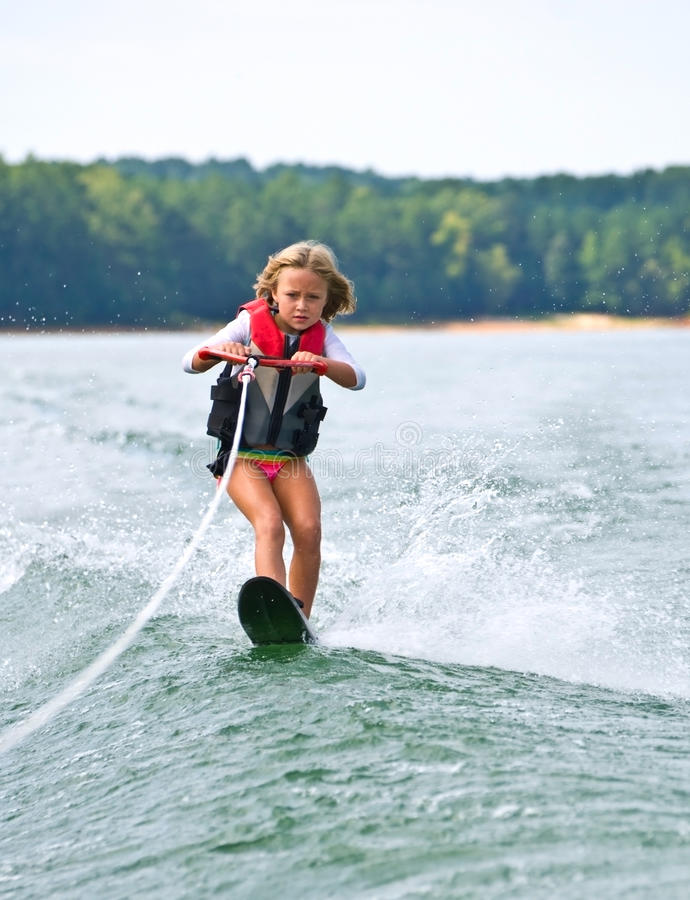 Young Girl Slalom Skiing stock photos