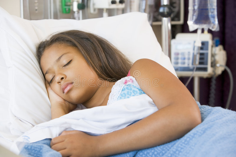 Young Girl Sleeping In Hospital Bed royalty free stock image