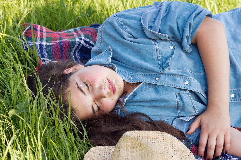 Young girl sleeping in the lawn royalty free stock photos