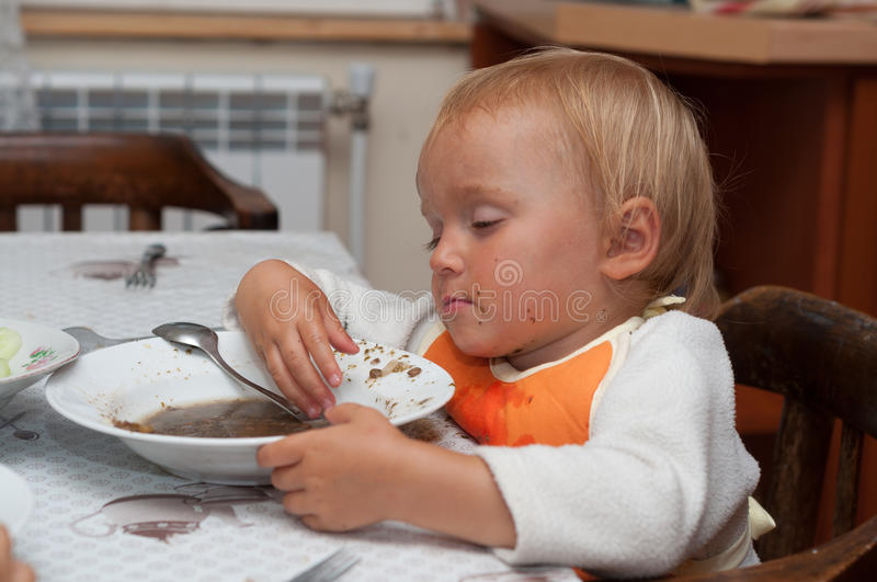 Young girl sleeping after lunch stock photography