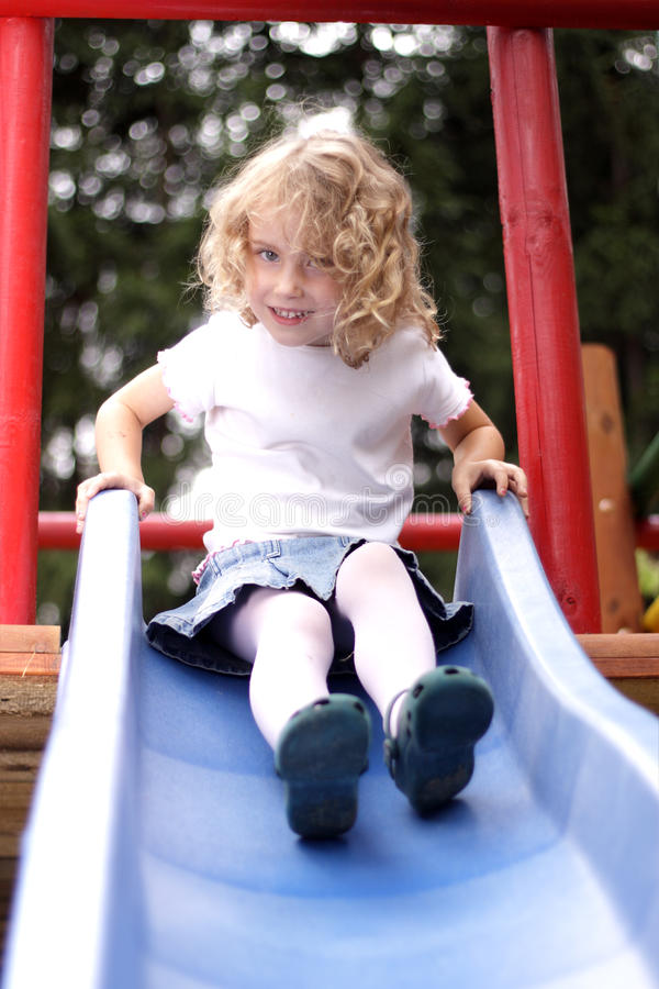 Download Young girl  slide stock image. Image of childhood, forest - 26422461
