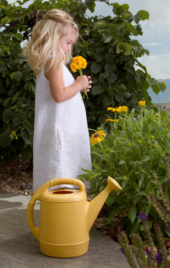 Download Young Girl Smelling Flowers Stock Image - Image: 25677767