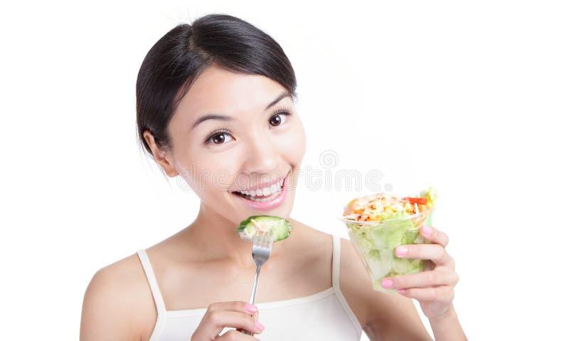 Young Girl Smile eating salad royalty free stock image