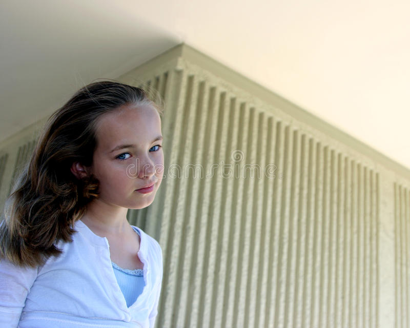 Download Young girl smiles softly stock photo. Image of blue, contemplation - 10163328