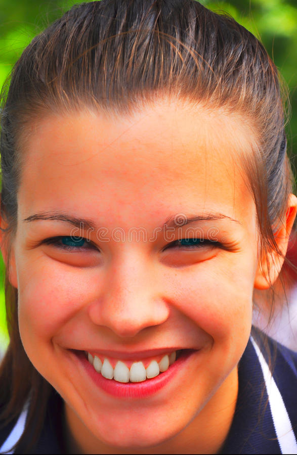 Young girl is smiling close up royalty free stock image