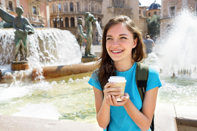 Young girl smiling and drinking coffee. stock image