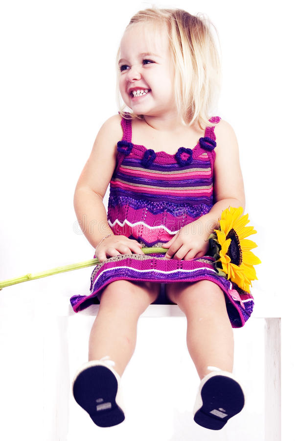 Download Young Girl Smiling With Sunflower Stock Image - Image: 18388895