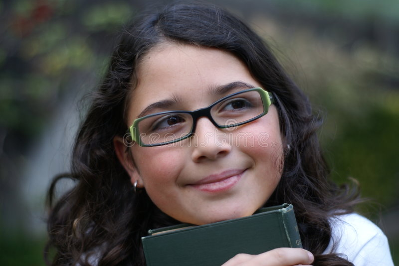 Young girl smiling wearing green glasses stock image