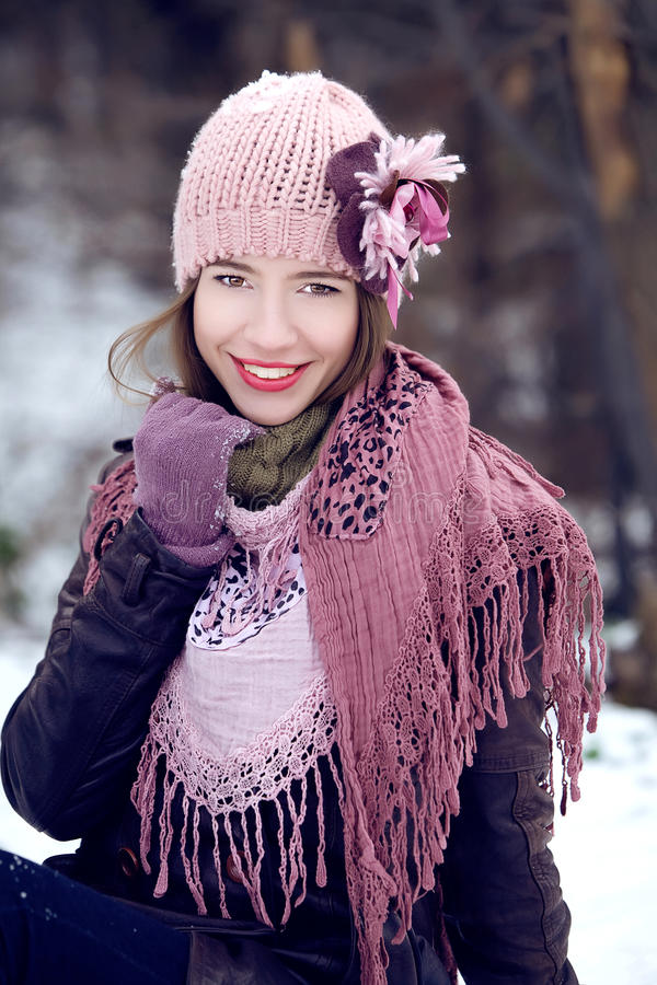 Young girl smiling in winter clothes stock photography