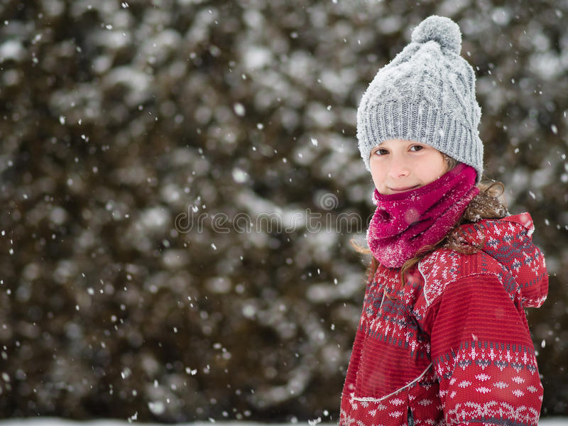 Young girl in the snow royalty free stock photos