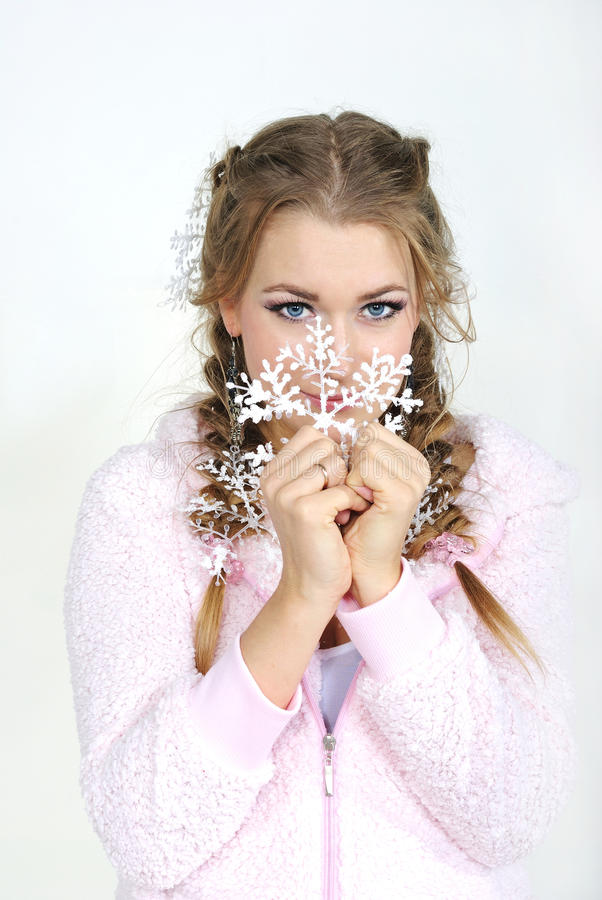 Download The Young Girl With Snowflake. Stock Images - Image: 23714394