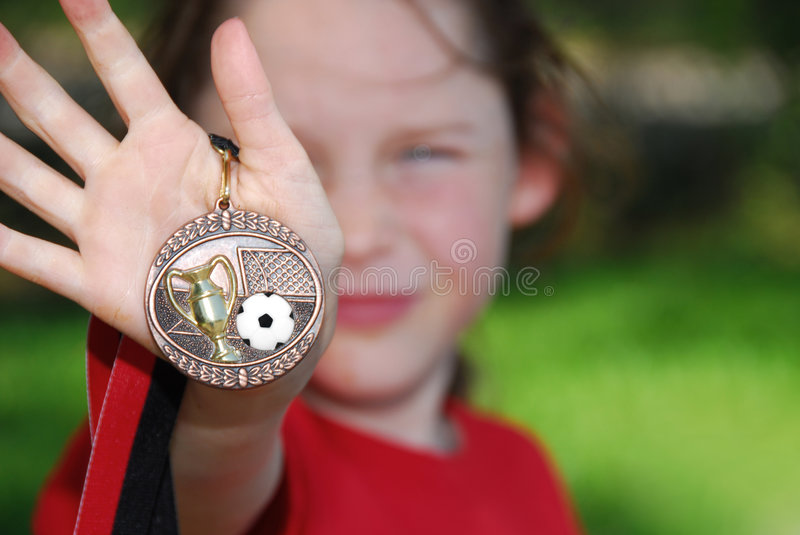 Young Girl with Soccer Medal stock photo